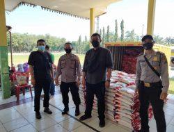 Polres Sergai Kawal Penyaluran Bantuan Masyarakat Terdampak COVID di Dolok Masihul